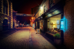 Empty Street in Keswick (Jacob Surland) Tags: caughtinpixels night england art fineartphotography lakedistrict highdynamicrange cityscape light landscape hdr merienda warmlight restaurant unitedkingdom geometry jacobsurland greatbrittain lines time fineart keswick country uk city marketsquare gb