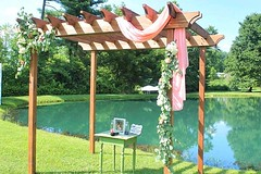 19875139_10212116771946598_811104436654792431_n (1) (sally_byler) Tags: wedding ceremony pergola swag fabric flowers summer ohio outdoors outside pond country