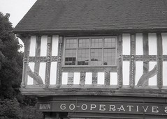 carved 1576 (OhDark30) Tags: olympus 35rc 35 rc film 35mm monochrome bw blackandwhite bwfp fomapan 200 rodinal halftimbered pub coop building carving 1576 avoncroft bromsgrove museumofhistoricbuildings