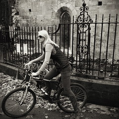 Girl on a bike, Library Square, York, England (chinese johnny) Tags: york england uk greatbritain 2013 iphone iphoneonly instagram iphone5c squareformat square bw blackandwhite monochrome moody melancholy winter streetphotography documentaryphotography documentary ambient reallifenotposed oldeurope vscocam vsco m flickrunitedaward