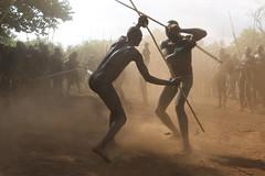 Fighting in dust (martien van asseldonk) Tags: martienvanasseldonk ethiopia donga stickfighting surma surmi