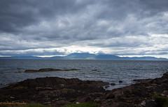 view from Portencross (Rourkeor) Tags: portencross scotland unitedkingdom gb arran hills clouds sunlight shadows rocks sea coast islands water reflections horizon sony sonyrx1r rx1r fullframe carlzeiss zeiss sonnar t 35mm