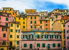 Brightly colourful houses (gordon.chiam) Tags: a7m2 italy vacation riomaggiore house colorful colors cinqueterre bluesky colourful warm windows outdoor architecture