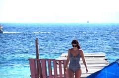 Old pier (thomasgorman1) Tags: pier sea ocean beach person woman swimwear seagulls gulls horizon boat island isla mujeres mexico yucatan