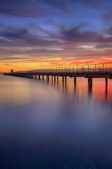 Petone Pier Sunset (Jos Buurmans) Tags: coastallandscape colourful colours evening foreshore huttcity landscape lowerhutt nature newzealand northisland petone petonewharf pier sea seascape sunset wellington nz
