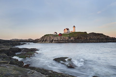 Nubble Lighthouse (Jonnie Lynn Lace) Tags: light lighthouse shore coastline coast ocean longexposure exposure sunset sky bluesky pink yellow orange blue colorful colours red glow flowingwater water architecture maine eastcoast rock nature exterior outside outdoors house home solitude peaceful serene beach nubblelighthouse nubble day sea seascape summer memorialday old history historic scenery harbour nikkor nikon d750 24mm digital flickr lens travel trip america american waves shadows island eau beautiful pretty aqua natur