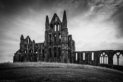 Where the Count dwells! (Anthony P26) Tags: category decay england external landscape northyorkshire places travel whitbyabbey yorkshire travelphotography building buildings abbey monastery remains ruin ruins blackandwhite whiteandblack bw mono monochrome vignette hill grass britain greatbritain english uk unitedkingdom canon canon1585mm canon550d sky cloudysky clouds cloudy outdoor architecture architecturephotography stone stonebuilding placeofworship gothic gothicarchitecture