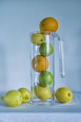 yellow green  and orange still life v.2 (Wendy:) Tags: lemons oranges fruit limes glass jug nik coloureffects