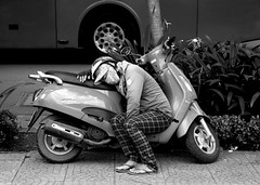 streets of saigon (wojofoto) Tags: saigon hochiminhcity vietnam people mensen sleeping slapen sleep asleep straatfoto streetphoto streetlife street blackandwhite zwartwit monochrome wojofoto wolfgangjosten candid motorbike tired woman vrouw frau