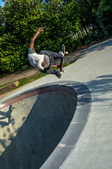 Street Skateboarder (Shawn Blanchard) Tags: street nc northcarolina durham skateboard park skate bullcity downtown city center pool green white black shadow concrete jump bull sun tree