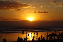 Double Six Sunset, Legian, Bali (scinta1) Tags: indonesia bali seminyak legian 66beach sunset beach people sea ocean water waterscape figues silhouette clouds sky stunning vibrant sun orange gold golden outside crowd