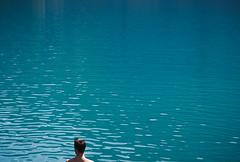 Tanguy (Roman Sojic) Tags: lake blue minimal negativespace nature water adventure outdoors boy