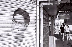 Happy Days (35mm) (jcbkk1956) Tags: mural shutters shops dof thai girls 35mm manualfocus analog pan100 ilford film blackwhite mono street thonglo sukhumvitroad thailand bangkok worldtrekker carlzeiss 45mmf28