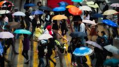 Rainy day in Hong Kong (Chas56) Tags: hongkong rain rainy rainyday people crowd street streetphotography umbrella umbrellas canon canon5dmkiii candid crossing pedestrians busy color colour colours bright
