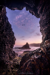 A Window into the Void (hillsee) Tags: seascape oregon oceanside seastack sunrise dawn light cave framing ocean water clouds colour landscape nature