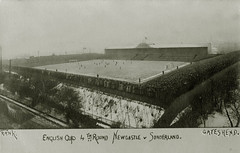 St James Park, Newcastle upon Tyne (Tyne & Wear Archives & Museums) Tags: newcastleunited sunderlandafc stjamespark newcastleupontyne sunderland football sport footballground crowd players facup postcard snow socialhistory game competition northeastofengland unitedkingdom postcards audience spectator referee groundsperson goal ground mark grain blur tree path picturepostcard facupquarterfinal 6march1909 insight glimpse daylight sky land debris slope standing watching flag pole building fence barrier roof wall shelter handwriting label englishcup 4thround newcastlevsunderland gateshead trank light surreal unusual fascinating interesting compelling digitalimage blackandwhitephotograph archives branch coat back hat winter cold followers team player