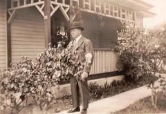 Off to the races (Boobook48) Tags: foundphoto verandah couple garden hat suit