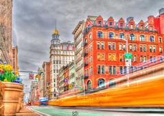NYC- Time does not stand still. (pcara22) Tags: newyork travel usa unitedstates us street urbanphotography colour fifthavenue flatiron yellowtaxi nikon