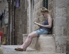 reading (=Mirjam=) Tags: nikond750 dubrovnik croatia oldtown reading girl wall stones historiccentre traveling roadtrip vacation juni 2017