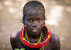 Portrait of a sudanese Toposa tribe girl refugee, Omo Valley, Kangate, Ethiopia (Eric Lafforgue) Tags: 1011years africa anthropology beaded beads beautifulpeople blackpeople child closeup day decoration developingcountry eastafrica ethiopia ethiopia0617297 ethiopian feminine headshot horizontal hornofafrica indigenousculture jewel jewelry kangate lookingatcamera necklaces omovalley onegirlonly ornamentation outdoors portrait refugee scars sudanese toposa traditionalclothing tribal tribe et