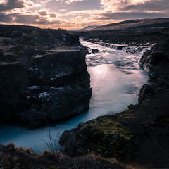 Hraunfossar waterfall - Iceland - Travel photography (Giuseppe Milo (www.pixael.com)) Tags: view iceland hraunfossar waterfall river nature water sky sunset travel hill clouds rocks onsale