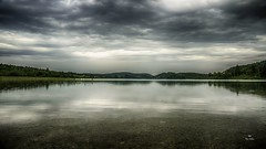 Entre ciel et eau... (Fred&rique) Tags: lumixfz1000 photoshop raw hdr lac ilay eau reflets pluie orage ciel nuages jura nature paysage