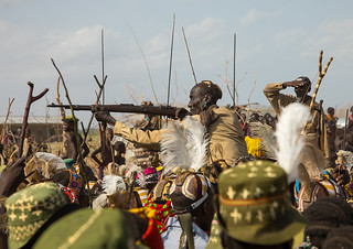 Man shooting with a kalashnikov during the proud ox ceremony in the Dassanech tribe, Turkana County, Omorate, Ethiopia