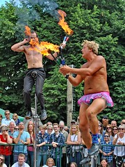 Winchester Hat Fair 2017 - Streetcomedy (Kay Bea Chisholm) Tags: men streettheatre sunshine comedy doubleact duo pinktutu flamingtorches unicycles thesquare hampshire 2017 hatfair winchester streetcomedy