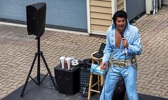 Elvis, He's Alive :) (zilverbat.) Tags: canada elvis canon bild streetphotography streetlife streetcandid straatfotografie straatfotograaf streetshot streetscene straatportret image people portrait portret candidphotography zilverbat peopleinthecity quebec shake pelvis king show podium suit blue city town performance