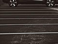 Un décimo (Luicabe) Tags: airelibre aparcamiento blancoynegro cabello enazamorado exterior línea llanta luicabe luis monocromático neumático paralelo rueda sepia vehículo yarat1 zamora