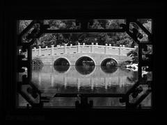 Framed Reflection (MacroMarcie) Tags: garden chinese bridge reflection olympus penf monochrome blackandwhite 7dwf landscape
