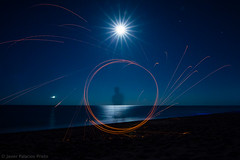 Who is that man? (Javier Palacios Prieto) Tags: long expoosure night fire lana de metal luna moon circle beach see sea seaside sky stars sparkles funken chispas noche