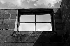 Down in Mississippi (38) (momentspause) Tags: canon5dmkiii canon50mmf18 niftyfifty blackandwhite bw sky wall window clouds mississippi abandoned