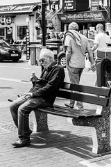 Relaxing with an Ice Cream (_John Hikins) Tags: bw black blackwhite blackandwhite harbour street white torbay d5500 devon nikon nikkor 50mm 50mm18 monochrome bench ice cream old man brixham