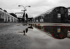 Project 365; #179 (iMalik1) Tags: project 365 days photo day challenge potd black white monochrome mono tone colour seperation shop red photoshop manipulation train transport for london ealing broadway station public central line tfl canon eos 600d cloudy imalik photography photographer landscape urban city life town rain puddle water reflection upside down reflections mirror district