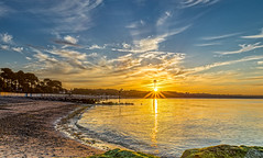 Solar Flare (nicklucas2) Tags: avonbeach seascape beach sunrise cloud sand beachhut sun flare