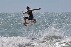 Skimming the waves (beyondhue) Tags: skimboard wave florida sun beach beyondhue balance air skimboarder man ocean sand splash flair
