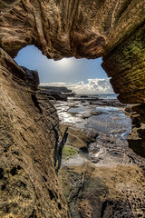 Inside looking out (JustAddVignette) Tags: australia cave clouds landscapes lowtide mahonpool maroubra newsouthwales ocean reflections rockpool rocks sea seascape seawater sky southeasternsuburbs sydney water waves