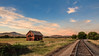 Old Homestead And The Train Tracks (http://fineartamerica.com/profiles/robert-bales.ht) Tags: barn buildings facebook fineart flickr gemcounty haybales idaho old people photo photouploads places states sunrise sunset house farm homestead ranch cattle barnwood fence butte squawbutte mountain idado landscape emmett treasurevalley scenicbiway americaphotography valley idahophotography beautiful sensational spectacular awesome magnificent peaceful surreal sublime magical spiritual inspiring inspirational canonshooter scenic superb building grass hay trees yellow blue robertbales sky traintracks tracks