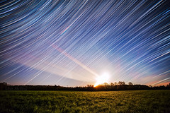 Moondial (Matt Molloy) Tags: mattmolloy timelapse photography timestack photostack movement motion nigh sky satrs trails lines moon rise clouds field grass trees violet ontario canada landscape nature lovelife