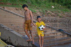 Cambodian children (Romane Licour) Tags: cambodia kratie mekong river playing football wet water children kids cambodian stairs village local localpeople people