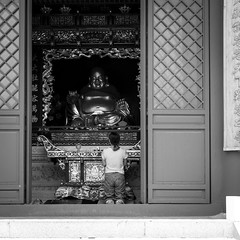 Body guard (Go-tea 郭天) Tags: qingdaoshi shandongsheng chine cn qingdao huangdao xiao zhoushan mountain temple buddha buddhism buddhist pray praying religion religious old traditional tradition history historical historic wish protected protection protect door open behind back backside lady woman young big gold golden rich fortune luck lucky frame fralmed street urban city outside outdoor people bw bnw black white blackwhite blackandwhite monochrome naturallight natural light asia asian china chinese shandong canon eos 100d 24mm prime alone lonely together candid