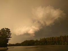 Storm clouds over Bass Lake (yooperann) Tags: cumulonimbus clouds bass lake marquette county upper peninsula michigan raining late evening