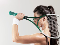 IS099L7X2 (adamcarterartdirector) Tags: 25to29years bicep blackhair caucasian concentration determination effort female headandshoulders holding longhair oneperson oneyoungadultwoman onlyonewoman profile serious sideview skill sport sportsclothing strength studioshot sweatband sweating tennis tennisplayer tennisracket vest whitebackground wristband youngadult