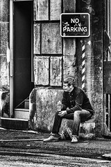Rest stop (tootdood) Tags: canon70d blackandwhite streetcandid monochrome stevenson square manchester people sitting sit sat seated noparking sign
