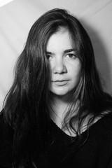 Portraits (alexandriacasella) Tags: shadows blackandwhite womanportrait portrait messyhair wavyhair