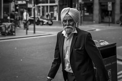 Hide and Sikh (Leanne Boulton) Tags: urban street candid portrait portraiture streetphotography candidstreetphotography candidportrait streetportrait eyecontact candideyecontact streetlife man male face facial expression look emotion feeling mood atmosphere movement motion walking sikh turban suit beard style tone texture detail depthoffield bokeh naturallight outdoor light shade shadow city scene human life living humanity society culture people canon canon5d 5dmarkiii 70mm character ef2470mmf28liiusm black white blackwhite bw mono blackandwhite monochrome glasgow scotland uk