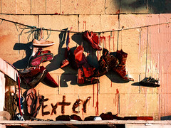 Exter- (Steve Taylor (Photography)) Tags: exter exterminate shoes trainers boots sandal pumps string laces wall brown red pink white block paint newzealand nz southisland canterbury christchurch footwear blood wire