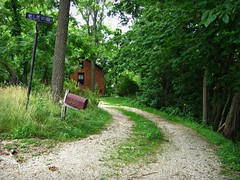 Seclusion (AmyEAnderson) Tags: galena illinois outdoor house driveway gravel curving lines mailbox sign signpost trees wooded lot address numbers elk grass tree leaves isolated remote secluded