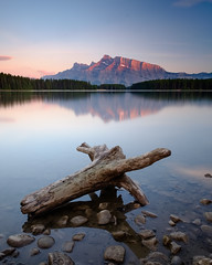 Two Jack Lake - Sunset [Explored] (Mister The Plague) Tags: littlestopper landscape 2stopsoftgrad solidnd gradnd leefilters longexposure mountain lake sunset reflection driftwood twojacklake banff alberta canada seven5 mountrundle rundle